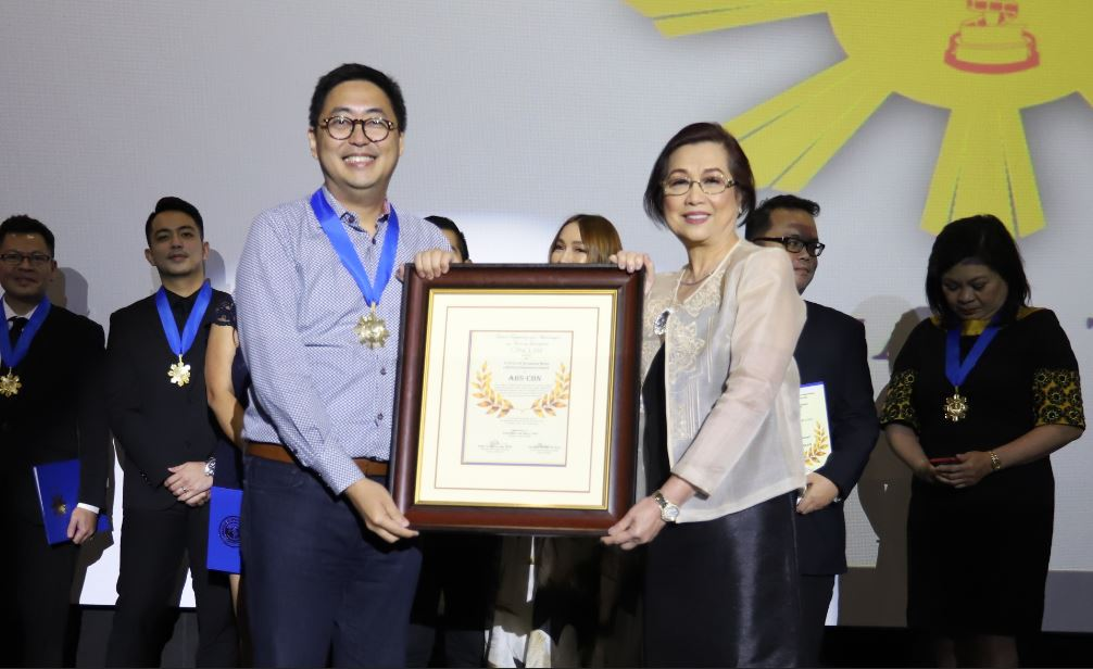ABS CBN receives a Tanglaw Broadcast Media Lifetime Achievement Award from Gawad Tanglaw
