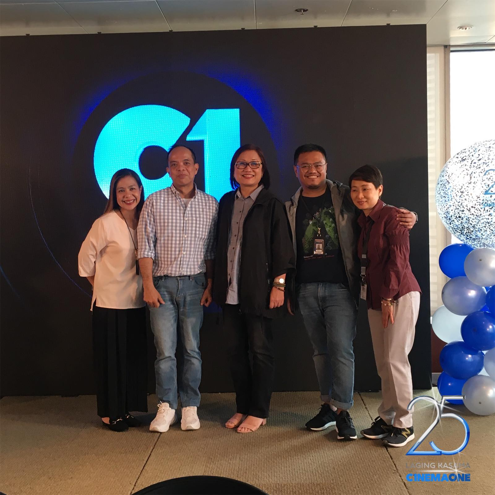 Cinema One channel head Ronald Arguelles with ABS CBN Films head Olivia Lamasan