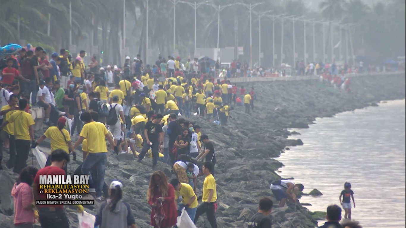 Volunteers participate in a clean up project in Manila Bay