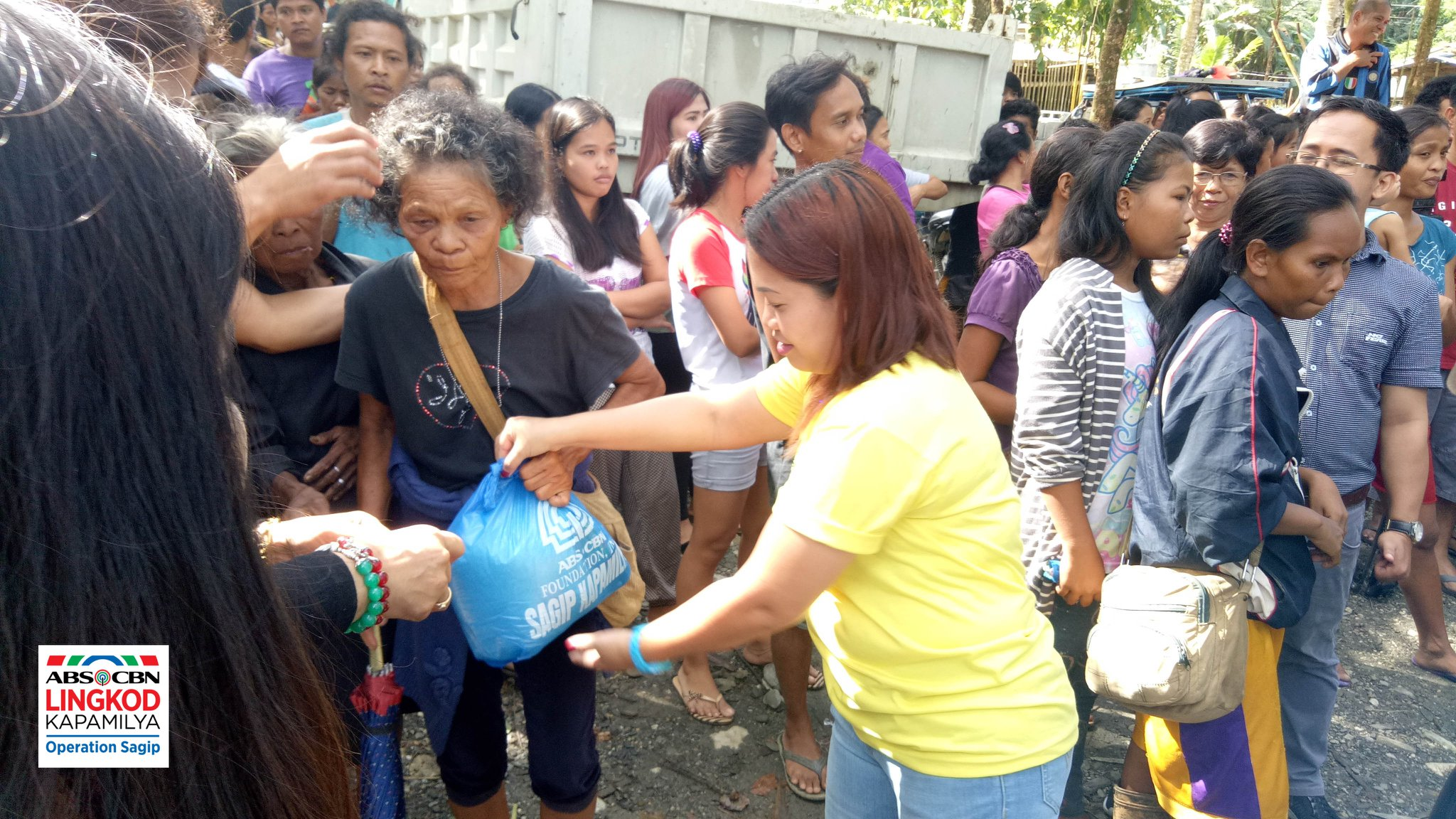Victims of Typhoon Usman receive food packs and relief goods