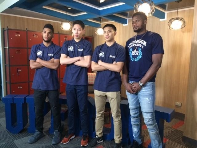 Jerrick Ahanmisi (far left) with his teammates from Adamson University