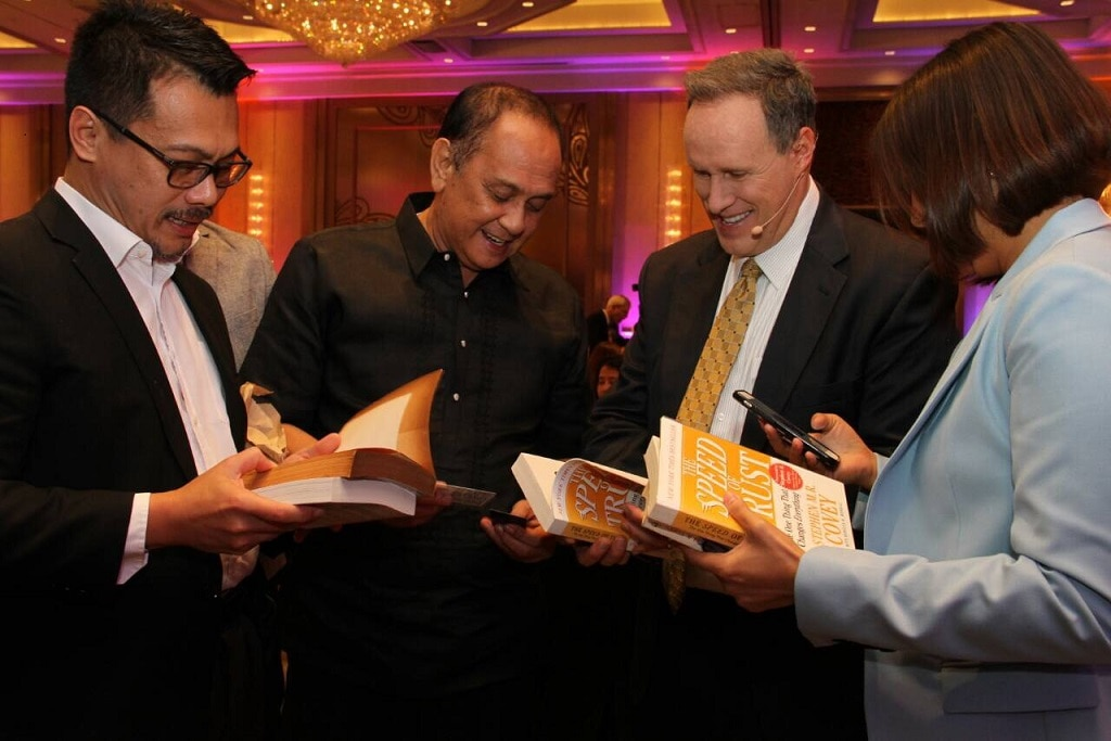 Guests have their copies of The Speed of Trust signed by bestselling author Stephen M R Covey